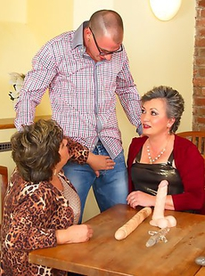 Three mature ladies playing around with one lucky guy