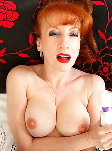 Hot red British MILF playing in her bed