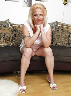 Blonde big breasted MILF playing with her toy