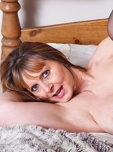 Big breasted mature slut loves to get wet on her bed
