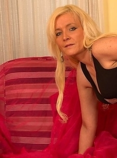 Horny blonde cougar doing her toy boy