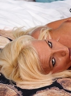 naughty blonde MILF playing with her toy