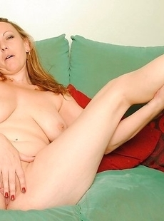 Hot MILF playing with her wet shaven pussy