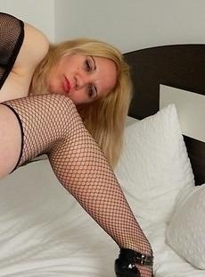 Naughty blonde mature slut teasing her pussy