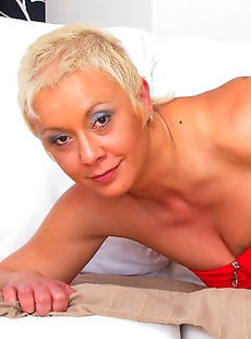 Naughty mature slut taking on two cocks at once
