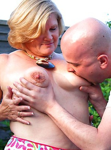 Naughty mature slut fucking a toy boy in the garden