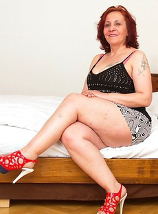 Horny mature lady getting ready to please herself