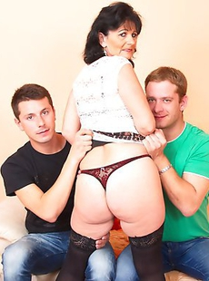 This horny mature slut loves two guys at once